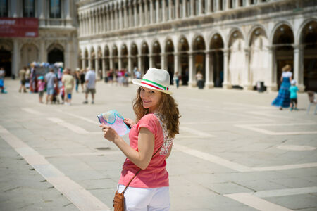 piazza san marco: Happy young girl with map at San Marco square in Venice