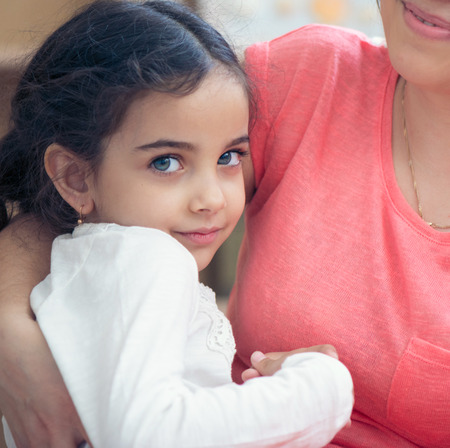 Portrait of lovely hispanic mother and daughter photo