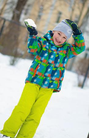 snowballs: Children throwing snowballs in snowy winter park