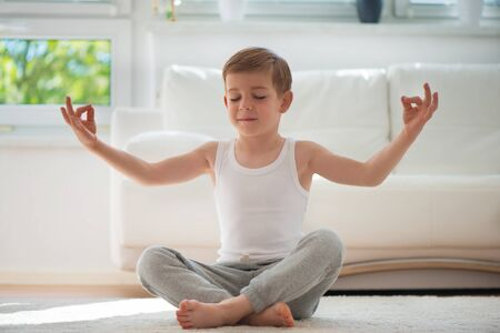 boy gymnast: Happy little  boy exercising sport at home