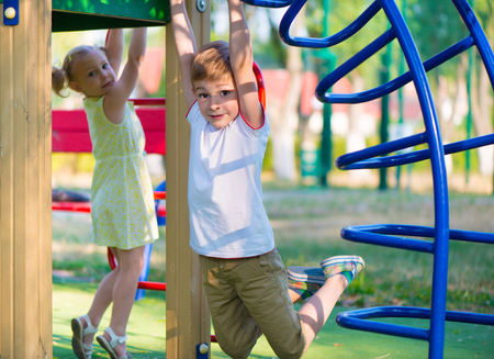 kid  playing: Happy cute kids having fun at playgraung Stock Photo