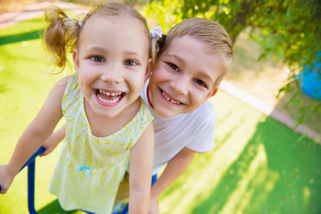 kids having fun: Happy cute kids having fun at playgraung Stock Photo