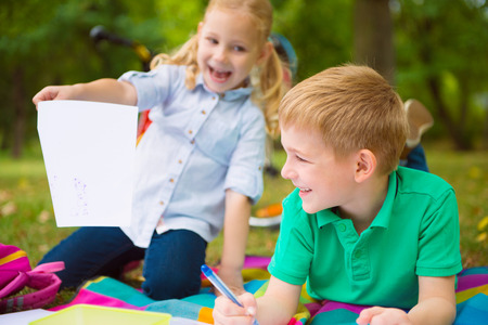 sommer: Two happy children  drawing in sommer park