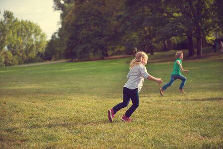 two children: Two happy children running in park in sunset