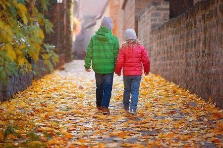 two children: Two cute children walking in autumn town