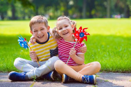 two children: Two happy children playing in garten with windmill