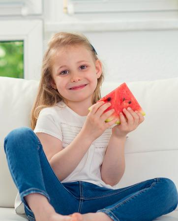 Cute little girl eating watermelon Zdjęcie Seryjne