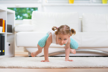 cute little girl: Morning exercises at home