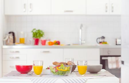 Halthy breakfast on table in white interrior kitchen