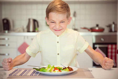 banging: Angry hungry boy child banging his fist on the table
