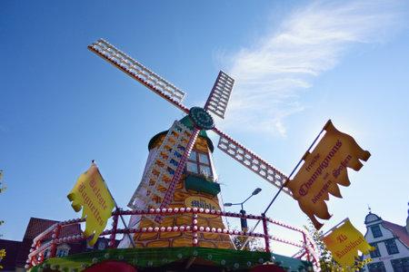 Ð¡olored windmill over blue sky at the festiva Oktoberfest: Erfurt, Thuringen, Germany, September25, 2016 Editorial