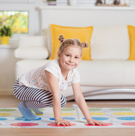 Pretty little girl have fun playing exciting game at home