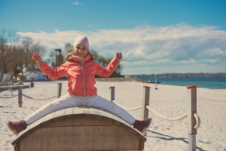 Portrait of adorable little girl playing at playground on a beach