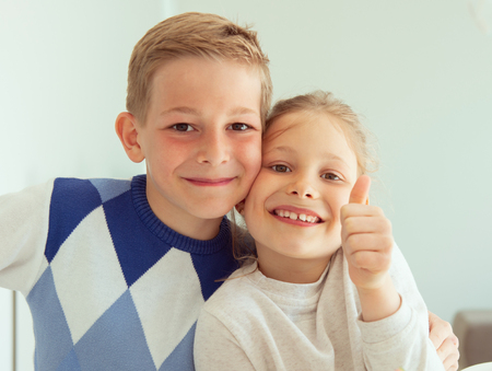 Cute little brother and sister having fun at home Banco de Imagens