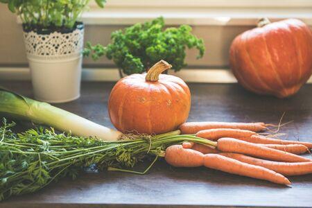 Autumn vegetables harvest on vintage wood background. Rural still life from above Stok Fotoğraf - 130065720