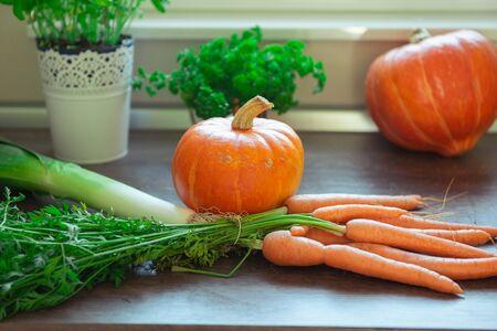 Autumn vegetables harvest on vintage wood background. Rural still life from above
