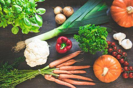 Autumn vegetables harvest on vintage wood background. Rural still life from above Stok Fotoğraf - 130065723