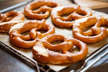 Closeup photo of handmade lye bun and bavarian pretzel in bakery