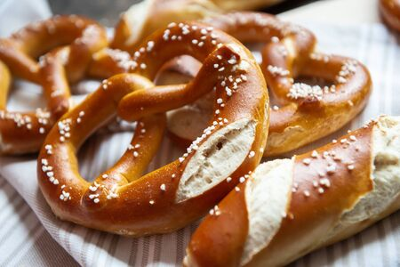 Closeup photo of lye roll bun and bavarian pretzel in bakery Banque d'images