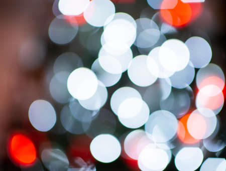 Photo of defocused colorful bokeh lights on christmas tree at new years tree Standard-Bild