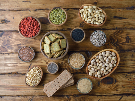Various super foods on a wooden background