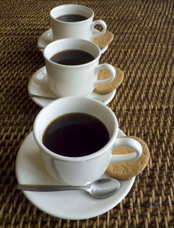 Three cups of coffee in a row Stock Photo - 2451371