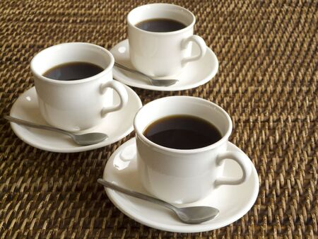 Three cups of coffee on a table Stock Photo - 2451372