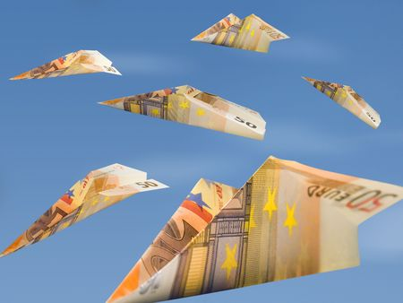 airborne vehicle: three fifty eurobills folded as paper planes Stock Photo