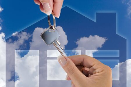 conceptual photograph of someone receiving the key for their new home Stock Photo