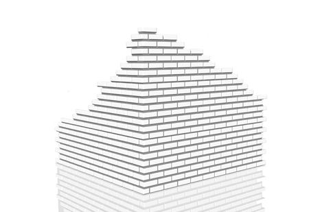 3d rendering of a white brick building being built or being broken down photo