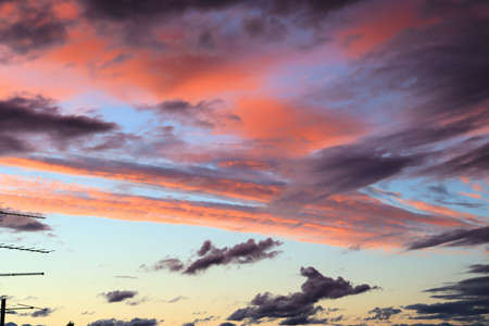 Blue and red colors of evening clouds, whimsical pattern at sunset