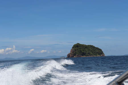 background waves and splashes, speedboat ride near tropical islands in ocean in asia Stock fotó