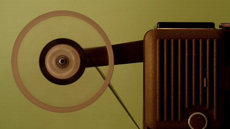8 mm projector running with vintage film Banco de Imagens