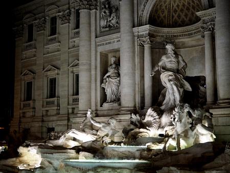 Fontana di Trevi illuminated at night Banco de Imagens