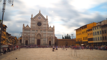 Long exposure of the church of Santa Maria Croce and the square in front of tourists. The sky is cloudy. Editorial