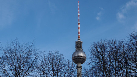 February 2018: view of the Berlin TV Tower in the trees of a nearby area. February 2017 in Berlin