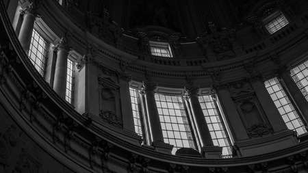 February 2018: Detail, in black and white, of the windows at the base of the dom of the Berliner Dome. Lighting is scarce but natural February 2017 in Berlin