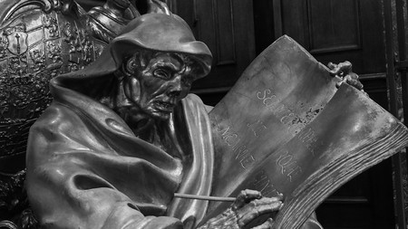 February 2018: Detail, in black and white, of a wooden statue inside the Berliner Dom. Lighting is scarce but natural February 2017 in Berlin