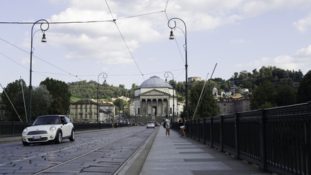 August 2018: Cars cross Vittorio Emanuele Bridge 1 towards the Gran Madre di Dio church. We are in the late afternoon of a warm and sunny day. August 2018 in Turin Editorial