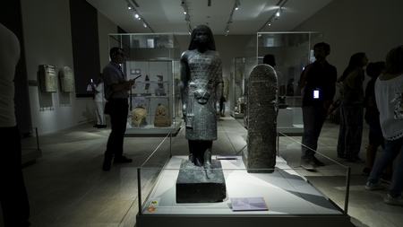 August 2018: Works exhibited inside the Egyptian museum. There are also visitors who look at the works with interest. August 2018 in Turin Foto de archivo - 109867369