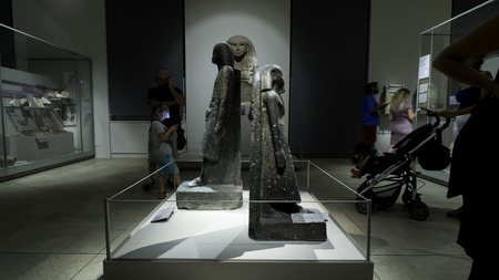 August 2018: Works exhibited inside the Egyptian museum. There are also visitors who look at the works with interest. August 2018 in Turin Foto de archivo - 109867370