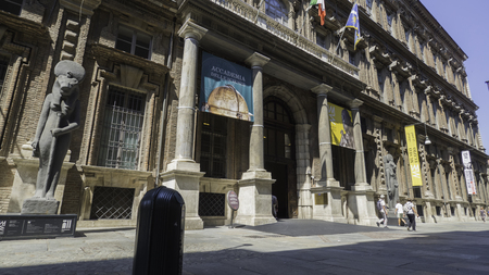 August 2018: Entrance to the Risorgimento building that houses the Egyptian Museum. Museum of the most important in the world We are in the late afternoon of a warm and sunny day. August 2018 in Turin