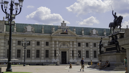 August 2018: Entry of the National University Library of Turin. In front of it is the statue of King Carlo Alberto. August 2018 in Turin Editorial