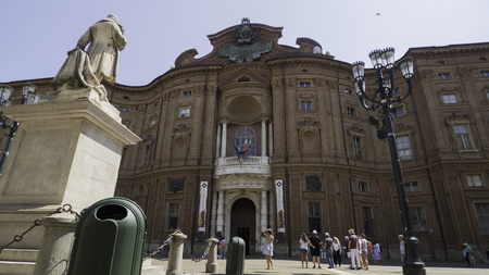 August 2018: Entrance of the Palace of the Princes of Carignano, the first seat of the Italian parliament. Many tourists stop to photograph the Risorgimento façade. August 2018 in Turin Editorial