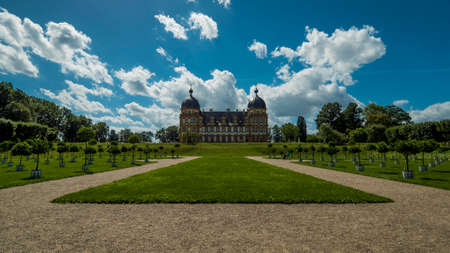 Bamberg 2019. Gardens and main façade of the Seehof castle near Bamberg. We are on a warm and sunny summer day and many people find refreshment in the Italian gardens of the castle. August 2019 in Bamberg.