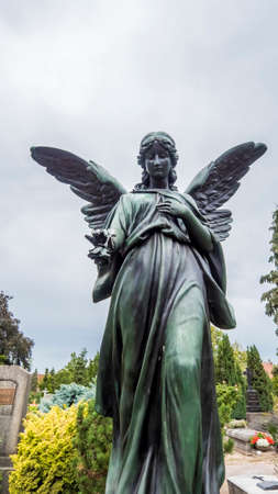 Nuremberg 2019. Bronze statue, aged by time, on a burial in the monumental cemetery of St. John's. August 2019 in Nuremberg. Editorial
