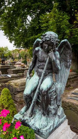 Nuremberg 2019. Bronze child angel statue, aged by time, on a burial in the monumental cemetery of St. John's. August 2019 in Nuremberg.