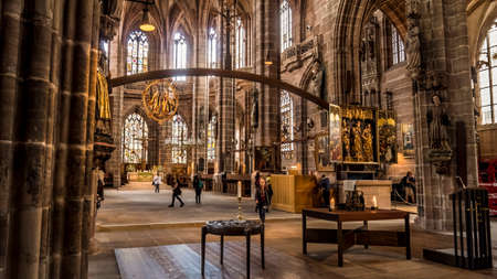 Nuremberg 2019. Interior nave of Cathedral of St. Lorenz, or Lawrence. We are on a Sunday and the faithful give way to visiting tourists. August 2019 in Nuremberg Editorial
