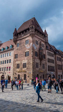 Nuremberg 2019. Tourists or ordinary citizens strolling in front of the main building of the Nassauer house. We are a sunny summer morning. August 2019 in Nuremberg