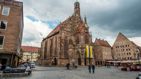 Nuremberg 2019. Tourists or ordinary citizens strolling in front of the Frauenkirche, or church of our lady. We are a sunny summer morning. August 2019 in Nuremberg